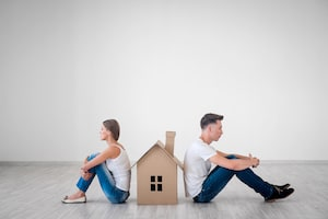 Couple with a Cardboard House